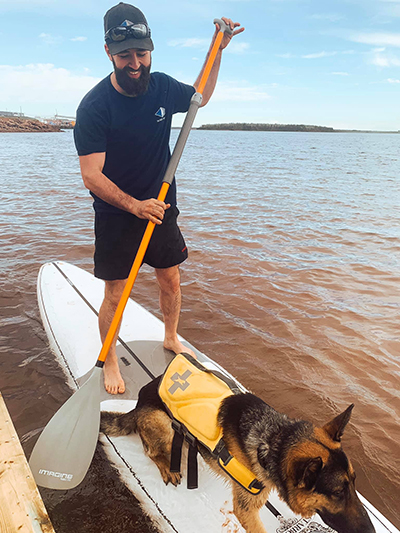 shane-and-trapper-on-paddle-board-2